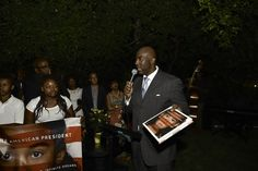 Caption: Photographer Matthew Jordan Smith speaking at the launch party.