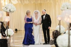 Bride walking down isle with parents at Curtis Center wedding ceremony. Photos by Jordan Brian Photography.