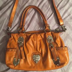 Kathy Van Zeeland purse Only used a couple of times. faux leather.  Does have a small scuff on the bottom, shown in pictures but other then that it's in GREAT condition Kathy Van Zeeland Bags