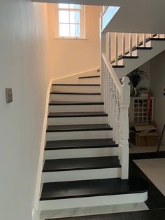 A single winder, white primed, cut string staircase with treads. The treads are painted to create a stunning contrast. Bespoke Staircases, Wooden Staircases, Curved Staircase, Glass Stairs, Metal Stairs, Painted Stairs, Winder Stairs, Staircase Manufacturers