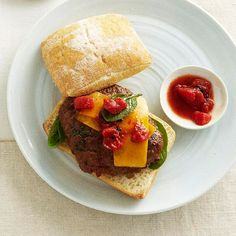 Give meat loaf a tasty makeover by serving it with cheddar, fresh spinach, and spiced tomatoes. Delicious for both lunch and dinner, the meat loaf sandwiches are baked until bubbly, then served atop toasted ciabatta buns. Ciabatta, Meatloaf Recipes, Beef Recipes, Hamburger Recipes, Meatloaf Sandwich, Beef Dip, Great Recipes, Favorite Recipes, Beef Dishes