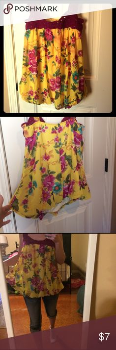 Forever 21 flowy blouse size small This is a cute spring top that is a golden yellow color with a plum purple knitted top and decorated with a plum colored flowers. It's very flowy and would look good as a maternity shirt!! It's in perfect condition .  Size small but is tight fitting . Ask questions open to offers! Forever 21 Tops