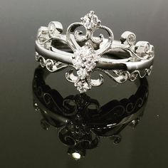 Fit for a princess 👑 This ring has been made in 18ct white gold set with 0.19ct of diamonds, with delicate millgrain beading finishing off this fabulous regal design.  www.robinsmoore.co.uk