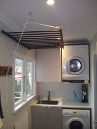 Hanging clothes drying rack