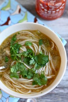 Pho  Ingredients:1 lb boneless, skinless chicken breasts, cut into chunks,  2 cloves garlic, minced,1 tbsp minced fresh ginger,1 tbsp sesame oil,1/4th tsp salt,6 cups chicken broth,1 jalapeno thinly sliced,3 green onions sliced,2 tbsp soy sauce,1 tbsp rice vinegar,2 baby bok choy chopped,  5 oz chinese noodles,sriracha sauce for serving,chopped cilantro