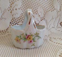 A personal favorite from my Etsy shop https://www.etsy.com/listing/269051048/lefton-porcelain-basket-small-porcelain