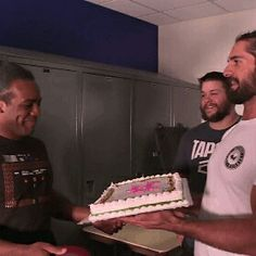 I think that is Xavier Woods and that is Seth Rollins and Kevin Owens!