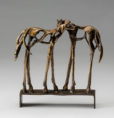 Comfort by Sandy Graves: Bronze Sculpture available at www.artfulhome.com Two horses stand side by side in an equine gesture of friendship and trust. The artist uses negative space and fluid form to capture each horse's graceful strength.