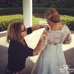 Behind the scenes...  Roz working her magic behind the scenes of the 2014 Glamour plus Collection look book photo shoot.   Love Note Photography #bridal #wedding #bride #fashion #style #photography #designer
