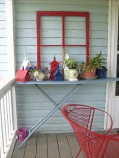 Recycle that old wooden ironing board.  You can also cut circles in the top and set your clay pots down in them.