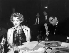 """Marilyn Monroe and Arthur Miller attending an after party of the premiere of """"Baby Doll"""" at the Waldorf Astoria, 1956."""