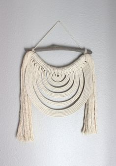 About 15 (38cm) wide and 25 (63.5cm) long from the top to the bottom of the longest fringe. #5 photo shows the dimensions Made from 100% cotton rope. If