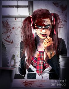 Dark grunge horror portrait of a killer school girl applying lipstick in a bathroom mirror with bloody smeared and cracked glass. Murder cover-up by Ryan Jorgensen
