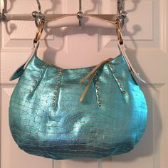 🛍 Maxx New York Metallic Teal Leather Hobo Bag Zip closure. 1 interior zip pocket. Rivets.  Measures: 16x4x11x4. Leather. Maxx New York Bags Hobos