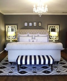 small master bedroom enlarged by matching mirrors and large rug completely under bed Beautiful, elegant bedroom design with gray walls, Z Gallerie Victoria Sleigh Bed, Restoration Hardware Crystal banister Lamps, Bombay Company nightstands, Ballard Designs mirrors, Ballard Designs white & blue striped Simone Bench and Jonathan Adler rug. [paint grays] Restoration Hardware Slate