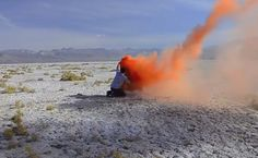 """John Knuth, video still from """"Freedom Forever"""", 2012  Idea of somebody's final gesture as a creative gesture. Smoke flares are a sculpture/performance that temporarily fills a space to then disperse across an environment."""