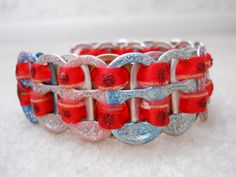 Original, Handmade with Bottle Tabs, Ribbon and Glitter Glue. Bracelet is connected by Jump Rings and a Lobster Clasp  Size - 8 1/2""