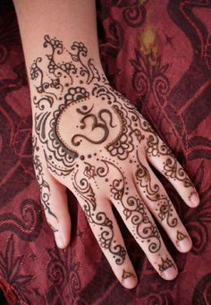 "A beautiful Henna design for the hands featuring the ""OM"" symbol.."