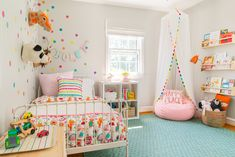 Toddler's Whimsical Bedroom Makeover Love the aqua rug + rainbow scalloped reading canopy. Neutral walls + lots of pops of color. The post Toddler's Whimsical Bedroom Makeover appeared first on Welcome! Big Girl Bedrooms, Little Girl Rooms, Girl Toddler Bedroom, Rainbow Girls Bedroom, Kids Bedroom Ideas For Girls Toddler, Toddler Room Decor, Modern Girls Rooms, Baby Bedroom, Small Toddler Rooms