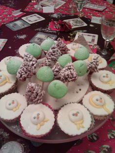 Green marshmallow trees, chocolate rice crispee cone trees, snowmen cupcakes
