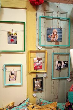 Photo display idea - hanging photos in over sized frames. Cute graduation photo display idea!