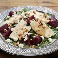 """Spinach & Beet Salad with Chicken  Real maple syrup--not the """"maple-flavored"""" fakes that line the supermarket shelves--is the key to the richly flavored dressing on this elegant salad. In this case, the darker the syrup the better; choose Grade B syrup if it's available, or the darkest """"Grade A"""" that you can find."""