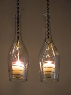 Wine Bottle Hanging Lanterns. I love this so much I want to buy a house just so I can use this idea. lol