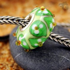 Murano glass bead, European Lampwork bead handmade glass bracelet charm finished with 925 Sterling silver rivets. Fits Pandora, Trollbeads, Chamilia and other European style big hole systems.   Bead size is approximately 15 x 8 mm Core size: 4.5 mm  Your handmade lampwork glass