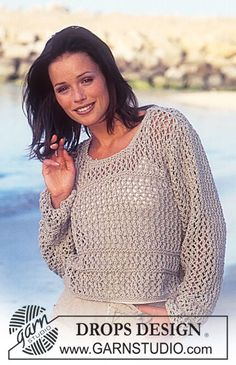 DROPS Sweater with lace pattern.