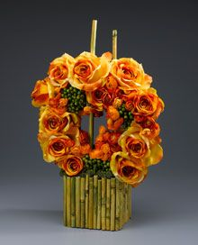 Orange Roses Wreath & Bamboo Centerpiece