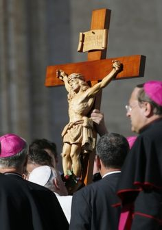 Pope kisses crucifix during general audience in St. Peter's Square at Vatican