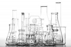 2-Industry Rooms: Medical/Science: Assorted science laboratory glassware chemistry equipment featuring glass beakers with graduated scientific cylinders and Erlenmeyer flasks over white Stock Photo