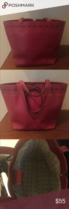 Kate Spade Vintage Bucket Purse/Handbag Pre-owned Kate Spade Bucket handbag in Red. This bag is in great condition.  All leather with black leather accent.  Polk-a-dot interior that is mildly dirty.  Magnetic closure that works well and handle shows almost no wear.  She does not make them like this anymore! kate spade Bags Totes