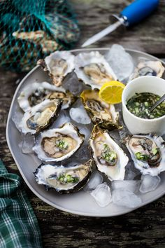 Fresh Oysters with Mustard Seed Mignonette with shallot, cucumber and fresh dill. Easy step by step guide to shucking and serving. | www.feastingathome.com