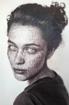 Great photo, if this was in a magazine they would probably photoshop out all of her freckles.