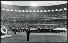 First opening night ceremony for the St. Louis Cardinals at the new Busch Stadium, 12 May 1966. Officer Don Miller saluting during playing of the National Anthem. Photograph by Robert C. Holt Jr. of the St. Louis Post-Dispatch, 1966. ©Missouri History Museum
