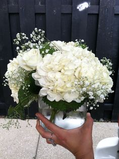 white hydrangea, white rose, and babysbreath centerpiece in clear glass cube (wedding)
