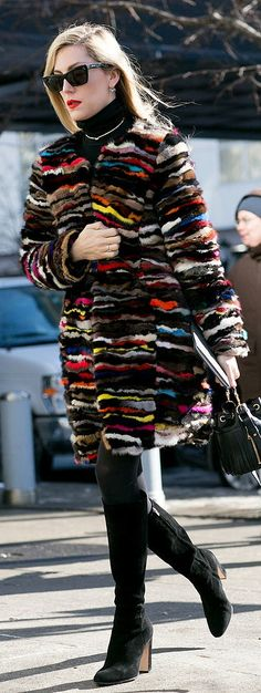NYFW street style: Tall boots and a colorful coat