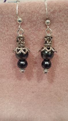 These great looking dangle pearl earrings go with anything from jeans to formal evening dress. They have an 8mm and 6mm pearls with antique silver findings. Shown here Hematite Pearls. They hang about 1 1/2 inches in length.  $14  #P007  JewelryArtByLinda@gmail.com