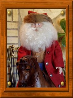 https://flic.kr/p/4ZfgBC | Cowboy Santa - OOAK Sculpted Doll | Giddy up, Rudy!  Santa's ready to ride in his duster and chaps!  This is another of my smaller sculptures.  He stands about 24 inches tall.