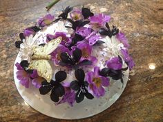 Purple, black and white flowers and butterfly cake