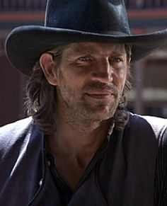 Eric Roberts, inspiration for Lucifer in RAGING FIRE. The devil wears a cowboy hat?