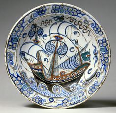 Fritware dish, painted in blue, green and black with a red slip under a transparent glaze. Turkey, Iznik circa 1600