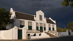 The town of Graaff Reinet, situated in the Midlands of the Eastern Cape, is the fourth oldest town in South Africa, and home to more than 220 official heritage sites and buildings. By: fly Cape Dutch, Adventure Is Out There, Heritage Site, Cape Town, Architecture Details, Old Town, Old Houses, Wonders Of The World, South Africa