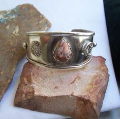Solid sterling handmade 6in. cuff bracelet with the sun and moon and star. Any custom additions you would like?  Just let me know.