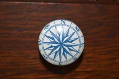 Compass Rose Dresser Drawer Knobs in Blue and White, Cabinet Pulls, Nautical Decor, Beach House, Nursery Decor, Man Cave Furniture, by HookAndKnob on Etsy https://www.etsy.com/listing/218511121/compass-rose-dresser-drawer-knobs-in