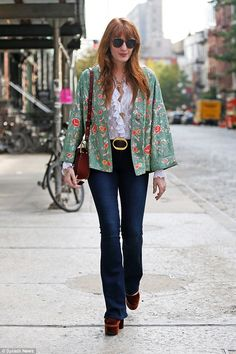 She's got fashion flare! Florence Welch, 28 wowed in denim bell-bottoms, vintage jacket an...