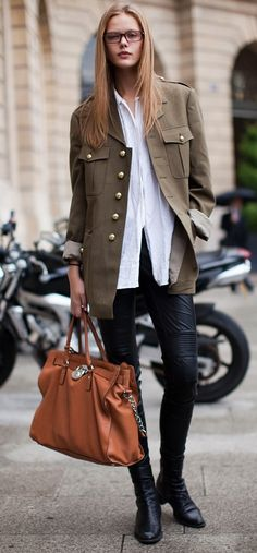 Chic street style in Paris in a military jacket + leather trousers + boots.