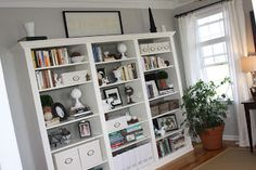 Billy Bookcases from Ikea ($69 each) and about $125 for plywood and moldings make your bookcases look custom, solid and gorgeous for a fraction of the price of custom. Reinventing Eden