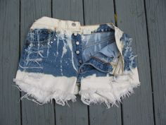 High Waisted Button Fly Levi Cut off Studded with Skulls Destressed  White Blue Art Shorts Vintage Jeans. $42.00, via Etsy.
